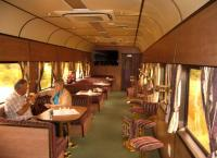 There is no shame in admitting that you can't quite stretch to £1000 for a single ticket from Cape Town to Johannesburg or vice versa in the Blue Train. But if you don't need a double bed to sleep on, and a private bathroom with bath, a similar level of luxury can be obtained in Premiere Class. The Lounge Car (no jeans allowed) is seen shortly after leaving Cape Town on 4th November 2005.<br><br>[Ken Strachan 04/11/2005]