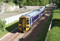 The 0911 Edinburgh - Tweedbank passing the site of Glenesk Colliery in bright morning sunshine on 22 May 2016. The train has recently crossed Glenesk Viaduct, the deck of which can be seen in the background. [See image 50584]<br><br>[John Furnevel&nbsp;22/05/2016]