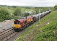 Recent clearing of vegetation has opened up a vantage point on Tarn Lane at Cinderbarrow where DB 66167 is seen heading south with the evening Hardendale to Margam containers on 23rd May 2016. The train has just crossed the Cumbria and Lancashire border. <br><br>[Mark Bartlett&nbsp;23/05/2016]