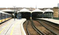 Platform view north at Blackfriars in the summer of 2005, before the station was rebuilt and extended south across the Thames. An early afternoon Luton - Sutton Thameslink train has recently arrived at through platform 4 via the Metropolitan widened lines. The lightly used bay platforms to the right stand vacant.<br><br>[John Furnevel&nbsp;23/07/2005]