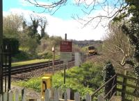 This photograph almost defines the country railway. A class 150 approaches the farmers' crossing North of Freshford station on a beautiful spring Saturday in 2016. [Ref query 6631]<br><br>[Ken Strachan&nbsp;30/04/2016]