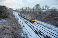 318259 (GW) north of Kilwinning with the 0945 Glasgow Central - Largs.<br><br>[Colin Howat&nbsp;28/12/2009]