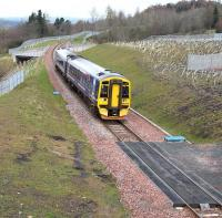The 1011 Edinburgh - Tweedbank photographed between Newtongrange and Gorebridge on 10 April 2016. The train is about to run over the Network Rail access pad located to the south of Gore Glen Viaduct.<br><br>[John Furnevel&nbsp;10/04/2016]