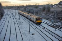 318253/256 (Both GW) north of Kilwinning<br> with the 1013 Ayr-Glasgow Central service.<br><br>[Colin Howat&nbsp;28/12/2009]