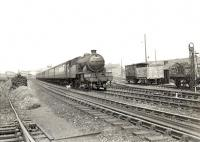 A Helensburgh Central - Bridgeton Central train passing the site of Yorkhill station (closed 1921) on 5 August 1957. Locomotive in charge is V1 2-6-2T 67623. [Ref query 19289]  <br><br>[G H Robin collection by courtesy of the Mitchell Library, Glasgow&nbsp;05/08/1957]