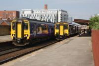 On the left a Class 156 DMU heading to Stalybridge while on the right is a Class 150 heading to Kirkby call at Salford Central on 04 June 2016. Significant improvements have been proposed for this station at platform level.<br><br>[John McIntyre&nbsp;04/06/2016]