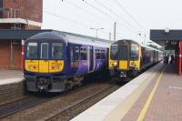 EMUs calling at Wigan North Western on 04 June 2016. The Class 319 is on a Preston to Liverpool service and the Class 350 is heading to Glasgow Central with a service from Manchester Airport.<br><br>[John McIntyre&nbsp;04/06/2015]