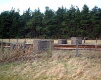 Concrete blocks on each side of the East Coast main line at Gravelpit Wood, 1 Km east of Ladybank which, together with a nearby pillbox, are what remains of a WWII defence post that would have enabled a barrier to be placed across the line.<br><br>[William Neill&nbsp;04/04/2001]