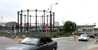 Gasholder No 8, last monument to the Imperial Gas, Light & Coke Company, still standing after more than 150 years. The iconic structure is seen looking west along Goods Way in July 2005. In the background work is in full swing on the transformation and expansion of St Pancras station, from Mr Barlow's roof on the left to the new domestic platforms up ahead. No 8 was removed in 2011 and, following refurbishment, relocated alongside the Regents Canal near St Pancras Basin in what is now Gasholder Park.<br><br>[John Furnevel&nbsp;23/07/2005]