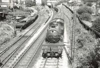 V1 67631 approaching Knightswood South Junction with a Helensburgh - Bridgeton train on 1 August 1957. Turning off to the west is the freight only Cowdenhill Branch, which served various industrial locations in the area. <br><br>[G H Robin collection by courtesy of the Mitchell Library, Glasgow&nbsp;01/08/1957]