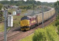 EWS 37405 passes Blindwells with the Oxwellmains - Powderhall empty 'bins' in June 2006.<br><br>[Bill Roberton&nbsp;/06/2006]
