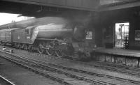 Gresley V2 2-6-2 no 60918 stands alongside the outside island platform at York station. The photograph is thought to have been taken in the late summer of 1960.<br><br>[K A Gray&nbsp;//1960]