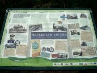 A display board sited near the former Hazelhead Bridge station detailing the Trans Pennine Trail now running along the trackbed of the Manchester to Sheffield and Wath 1500V DC electrified line. The board also describes the history of the line and the various owning railway companies during its operational period.<br><br>[David Pesterfield&nbsp;01/06/2016]