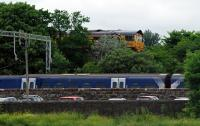 With the tree growth, this is definitely the wrong time of year for this photograph. The service from Helensburgh Central arrives and is held back for some time while the empties from Fort William drop down through the closed Craigendoran Upper and then a Sprinter heads north.<br><br>[Ewan Crawford&nbsp;13/06/2016]