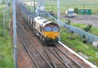 Coal empties approaching Carstairs from the south in the summer of 2006 behind EWS 66203.<br><br>[John Furnevel&nbsp;11/07/2006]