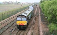 DRS 66401 is about to move a container train through Fouldubs Junction and past the W H Malcolm Grangemouth depot on 30 July 2008 before heading for Aberdeen. Meantime, a classmate is standing at signals in the background awaiting the road into the depot.<br><br>[John Furnevel&nbsp;30/07/2009]