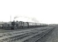 An Ardrossan Winton Pier - Glasgow St Enoch train approaching Kilwinning station on 4 July 1959 behind Fowler 2P 4-4-0 no 40624. <br><br>[G H Robin collection by courtesy of the Mitchell Library, Glasgow&nbsp;04/07/1959]