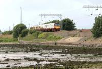 An Airdrie - Helensburgh Central train running along the north bank of the Clyde near Cardross in July 2004.<br><br>[John Furnevel&nbsp;08/06/2010]