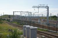 The new Hitachi maintenance facility for the Class 800 IEP trains at Stoke Gifford seen from a passing train between Filton Abbey Wood and Bristol Parkway on 21 June 2016. Whilst there are several sidings at this (east) end of the site, further west there is a large building offering covered facilities.<br><br>[John McIntyre&nbsp;21/06/2016]