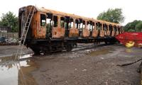 The ruined coach of the Swindon and Cricklade's Thumper Unit is now being stripped of any remaining good parts before being scrapped.<br><br>[Peter Todd&nbsp;18/06/2016]