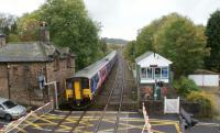 A Buxton to Manchester service has just called at Furness Vale station behind the photographer on 19 October 2010. This service comprised of 3 sets, a mixture of Class 156 and 150s, in order to get one of them back to Manchester for maintenance.<br><br>[John McIntyre&nbsp;19/10/2010]