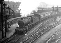 A Great Western 2-6-0 about to take out a train from Southampton Terminus in the late 1930s. The train is thought to be a cross country service via the former Didcot, Newbury & Southampton route. Southampton Terminus closed to passengers in September 1966 although the listed former goods depot in the background still stands (2016). [Ref query 12670] <br><br>[Bruce McCartney Collection&nbsp;//]