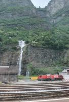An impressive backdrop to the SBB loco depot at Biasca, at the southern end of the Gotthard pass, where three diesel shunters were stabled in the depot yard in June 2016. The final drop of the waterfall is actually two separate cascades that cross each other.<br><br>[Mark Bartlett&nbsp;25/06/2016]