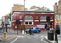 <I>Found it!</I> Star of the Northern Line - Mornington Crescent station in July 2005 looking east across Hampstead Road. [See image 12645]<br><br>[John Furnevel&nbsp;23/07/2005]