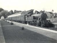 An afternoon train for Airdrie prepares to leave Milngavie platform 1 in the summer of 1957. Locomotive in charge is Gresley V1 2-6-2T 67618 of Kipps shed. <br><br>[G H Robin collection by courtesy of the Mitchell Library, Glasgow&nbsp;02/07/1957]