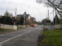 Looking south across Princess Road level crossing, the middle of three within the village of Strensall east of York. York Road level crossing is a short distance to the west, whilst that on Lords Moor Lane, by the former station site, is a greater distance east.<br><br>[David Pesterfield&nbsp;03/04/2016]