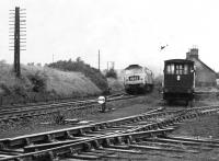 An unidentified Brush Type 4 brings the 1425 Stranraer Harbour - Newcastle Central through the closed station at Carronbridge. Thought to have been taken in the early 1970s. [Ref query 47971]<br><br>[Bruce McCartney Collection&nbsp;//]