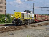SNCB 7712 leaves Bruges Yard with empty car transporters for the docks on 24 June. NB The local Flemish spelling of Bruges is Brugge and the running-in boards have this spelling.  All train announcements were in Flemish ...<br><br>[Bill Roberton&nbsp;24/06/2016]