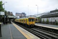 A Chester service calls at Birkenhead Central on 29/06/2016.<br><br>[David Panton&nbsp;29/06/2016]