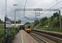 The nicely numbered 323232 pauses at Heald Green on the Styal Loop with a Crewe to Manchester Piccadilly (via the Airport) stopping service. Overhead an Easyjet Airbus has wheels down on final approach to Manchester.<br><br>[Mark Bartlett&nbsp;17/06/2016]