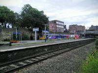 Overview of Wigan Wallgate on 30/06/2016 with the rear of a Southport to Manchester combination at the far platform. <br><br>[David Panton&nbsp;30/06/2016]