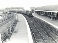 A Glasgow St Enoch - Largs train arrives at Kilwinning on 4 July 1959 behind 2P 4-4-0 40667.<br><br>[G H Robin collection by courtesy of the Mitchell Library, Glasgow&nbsp;04/07/1959]