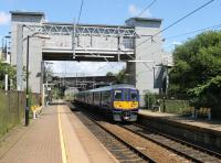 Northern 319376 calls at Wavertree Technology Park with a Warrington Bank Quay to Lime Street service on 13th July 2016. The station opened in 2000 and the booking office on the bridge is at street level, connected on either side by footbridges. <br><br>[Mark Bartlett&nbsp;13/07/2016]