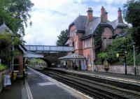The attractively maintained station in the leafy suburb of Cressington.<br><br>[David Panton&nbsp;29/06/2016]