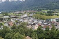 Interlaken Ost, as seen from a descending car on the Harder-Kulm funicular. Standard gauge lines from the west and metre gauge lines from the south and east all terminate here. The platforms on the left are standard gauge with stabling roads and service depot beyond. The metre gauge BOB line curves in from the far right of the picture past the blue and yellow stock. In the middle another metre gauge line, the Zentralbahn from Luzern, can also be seen dropping down from an embankment alongside the stabling roads.<br><br>[Mark Bartlett&nbsp;19/06/2016]