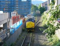 A fine summer morning in July 2005 sees EWS 37427, running light engine from Millerhill to Powderhall depot, approaching its destination. The locomotive had been diagrammed to work the morning <I>Binliner</I> to Oxwellmains. [See image 4773] <br><br>[John Furnevel&nbsp;14/07/2005]