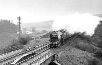 4472 <I>Flying Scotsman</I> photographed heading north on the ECML near Grantshouse on 10 May 1969 with a Flying Scotsman Enterprises 'Positioning Special'.<br><br>[Dougie Squance (Courtesy Bruce McCartney)&nbsp;10/05/1969]