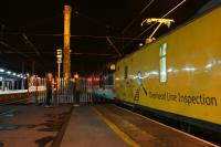 A Network Rail test train stops at Preston just before midnight  on 15 July 2016 whilst working from Blackpool to Derby, although not the direct route. The train had run earlier run via Preston, Blackburn, Hellifield, Carnforth, Morecambe (reverse), then back tracking to Blackburn where it travelled to Bolton(reverse) back to Blackburn (reverse) and then Preston (reverse). It finally headed south towards Derby with the overhead line inspection coach having the pantograph raised. What was noticeable was the foliage stuck in the pantograph which it appears to have collected earlier in the journey. The loco on the front for the next part of the journey was Inter City liveried 37254 and Colas liveried 37175 was on the rear.<br><br>[John McIntyre&nbsp;15/07/2016]