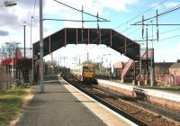 A train for Lanark about to pick up a solitary passenger at Bellshill on 13 February 2006.<br><br>[John Furnevel&nbsp;13/02/2006]