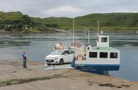The ferry <I>Belnahua</I> off loading at the Cuan Slipway on the Isle of Seil having crossed the Cuan Sound from the Isle of Luing, whose slipway can also be seen across the channel. The <I>Belnahua</I>, named after a local slate island, was built at Campbeltown Shipyard in 1972. <br><br>[Mark Bartlett&nbsp;24/07/2016]