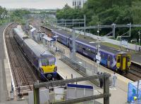 View from the steps at Springburn.  334032 at platform 3 with the 13.52 to Dumbarton Central with 156434 on a Stirling - Queen Street service alongside.<br> <br><br>[Bill Roberton&nbsp;18/07/2016]