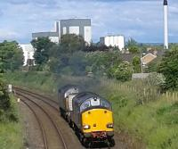 Two class 37's passing Dalston Cumbria on route to Sellafield on 21/06/2016. In the background is the Dalston Nestle plant.<br> <br><br>[Brian Smith&nbsp;21/06/2016]