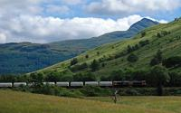 66740 heads south with the empties from the Lochaber Smelter in July 2016. Ben Lomond rises in the background.<br><br>[Ewan Crawford&nbsp;29/07/2016]