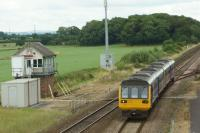 A pair of Class 142s head west towards Blackpool and pass Salwick No.2 signalbox on 30 July 2016. It would appear from the steelwork that the box is in need of some support so that it can continue to signal trains for a little while longer. Under the electrification work on the line to Blackpool North, Salwick No.2 will close. At the moment it works to Preston PSB in the east and Kirkham in the west.<br><br>[John McIntyre&nbsp;30/07/2016]