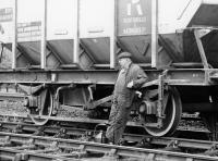 An undated photograph taken during wagon maintenance at Galashiels lyes. The gentleman featured is Mr J Scott.