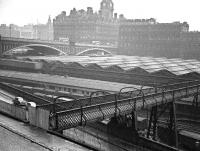 The south end of the footbridge that once spanned Waverley station between Calton Road and Jeffrey Street. The bridge was ^temporarily closed^ in the 1950s and gradually fell into disrepair. This view shows the Jeffrey Street end of the closed bridge on a wet day in the 1960s. The last remnants of the old bridge were removed from the Calton Road entrance during the roof renewal works in 2013. [See image 6021]